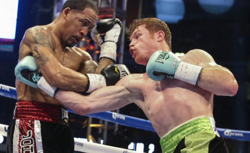 May 9, 2015; Houston, TX, USA;  James Kirkland (left) and Canelo Alvarez (right) fight in a super welterweight bout at Minute Maid Park. Alvarez defeated Kirkland with a knockout in the third round. Mandatory Credit: Troy Taormina-USA TODAY Sports ORG XMIT: USATSI-225094 ORIG FILE ID:  20150509_gav_at5_187.jpg